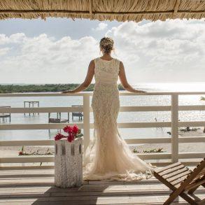 Bride overlooking ocean at Mahogany Bay Resort