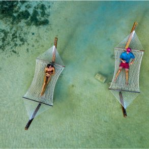 hammocks over water at mahogany bay beach club