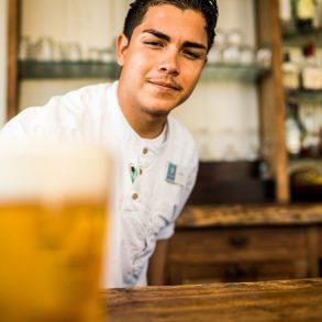 bartender serving beer at shaken