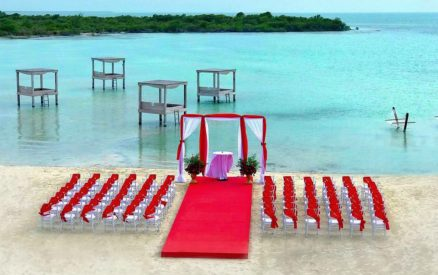 beach club wedding red carpet